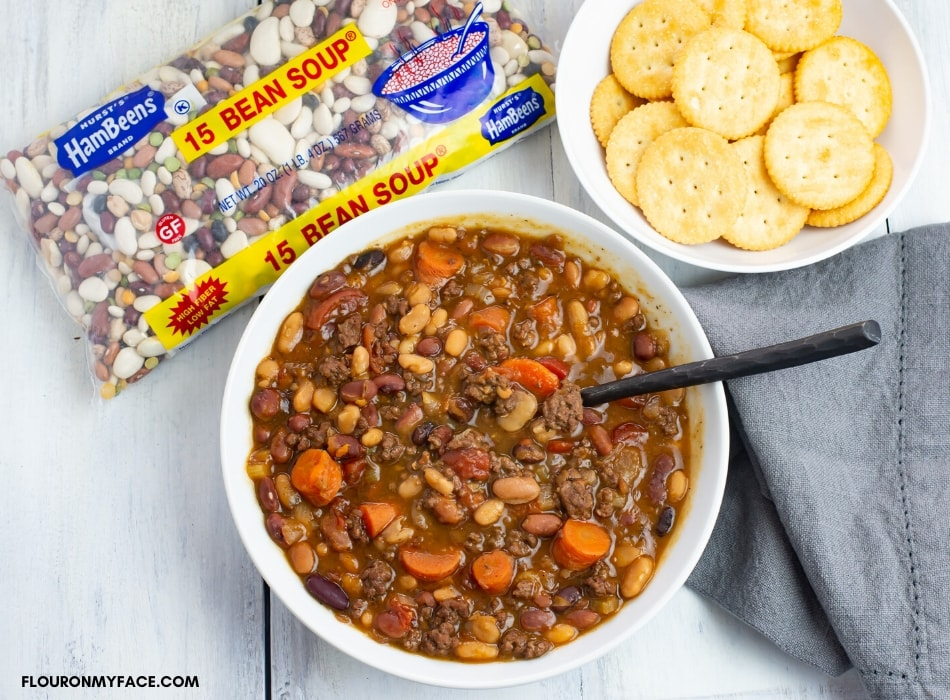 Pressure Cooker Bean and Ground Beef Soup Recipe in a bowl with a bowl of crackers