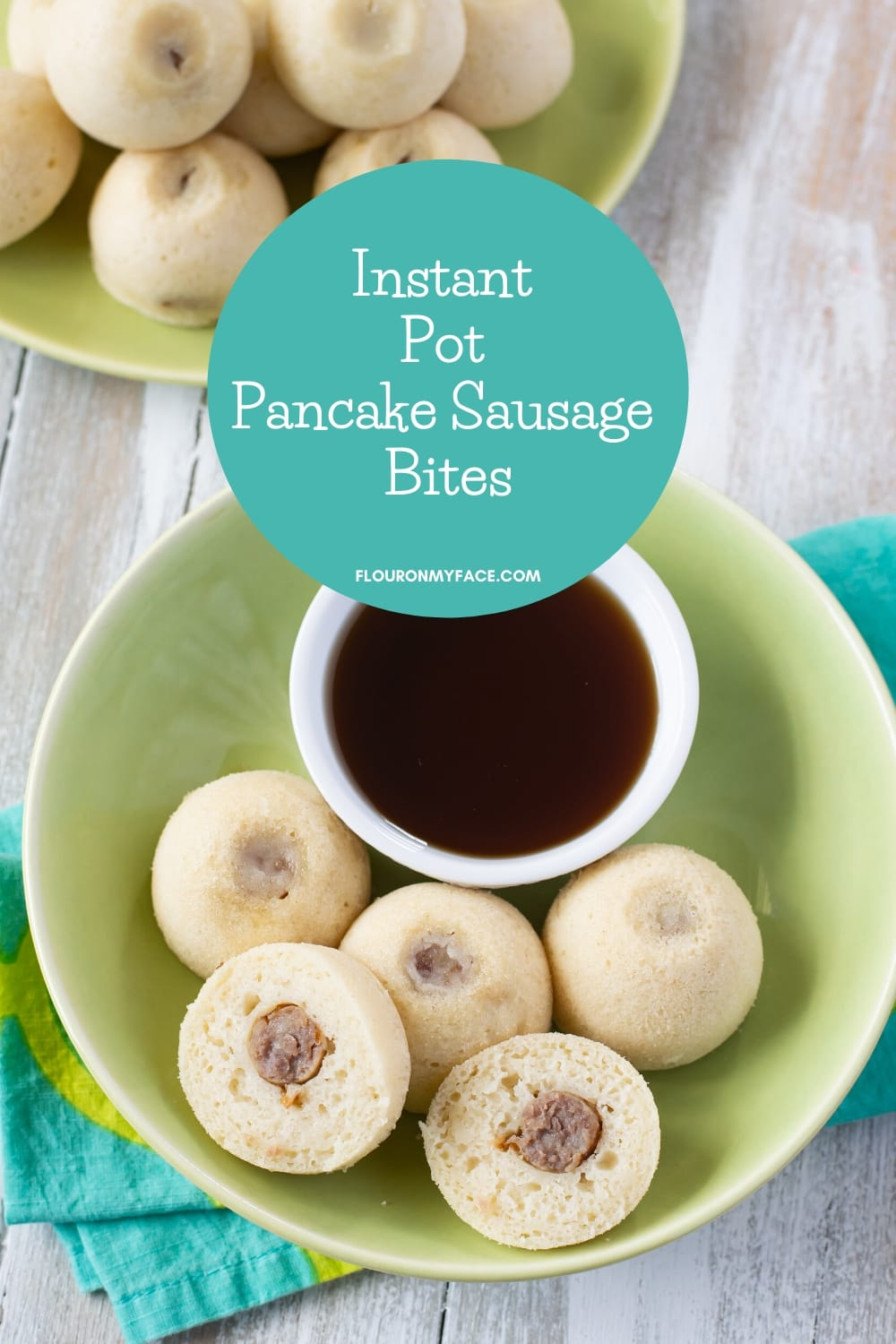 Instant Pot Pancake Sausage Bites on a plate with a bowl of pancake syrup