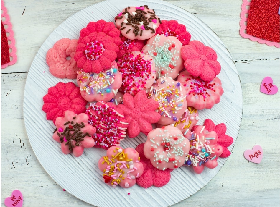 Pink Flower Spritz Cookies on  a round white serving tray
