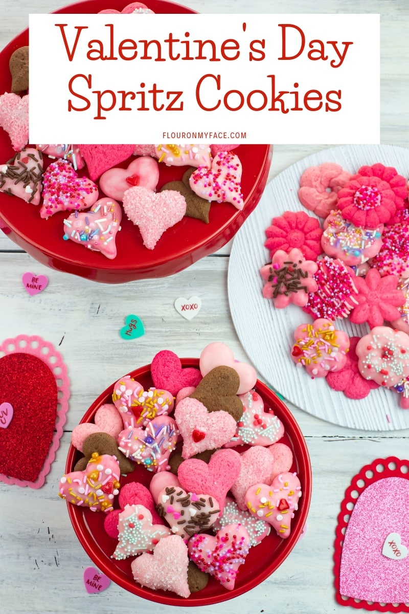 Valentines Day Spritz Cookies on a cake stand and plate.