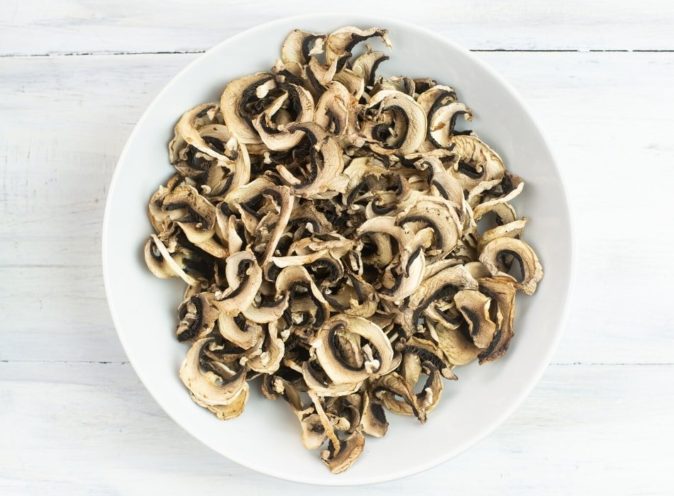 dried bella mushrooms in a white glass bowl