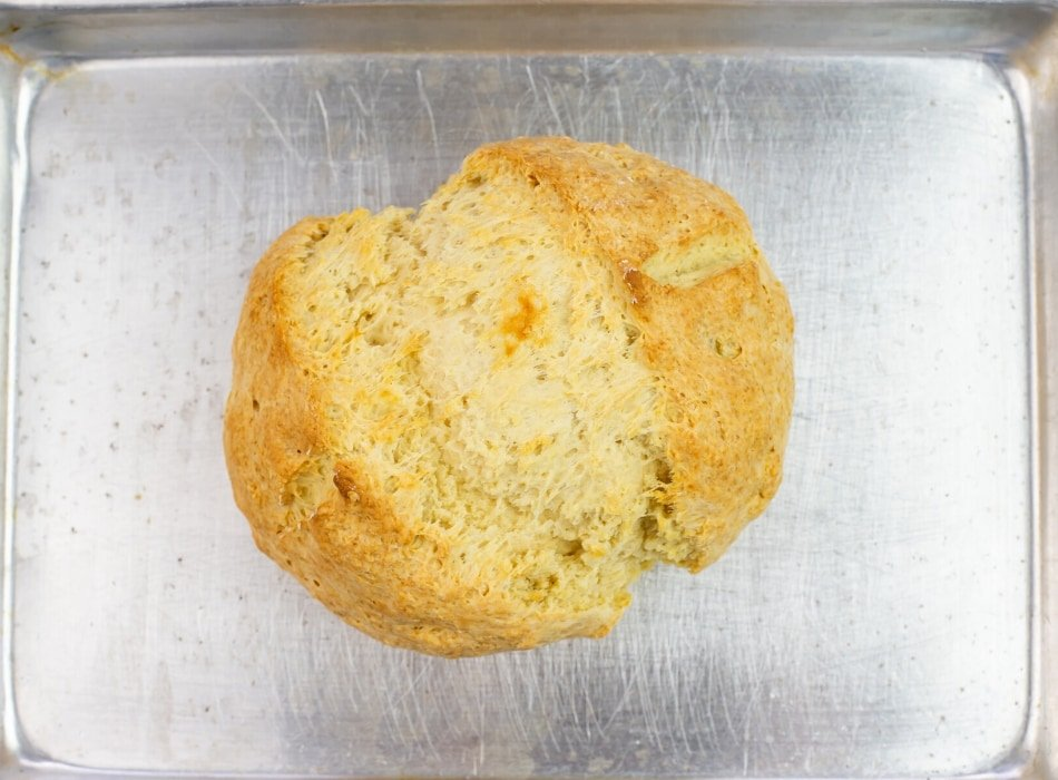 Freshly baked Irish Soda Bread on the baking sheet fresh out of the oven.