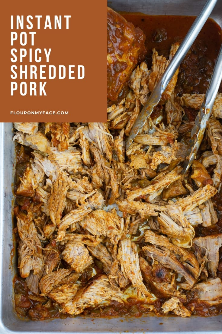 Instant Pot Spicy Shredded Pork Recipe on a tray while shredding for recipes