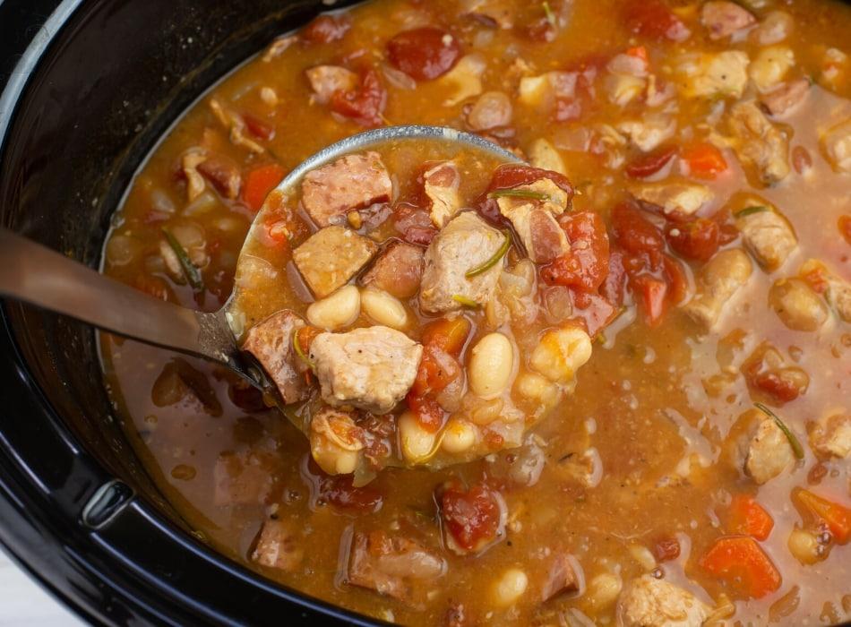 a ladle scoop full of rustic pork stew
