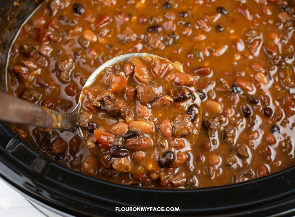 a ladle full of chunky turkey chili