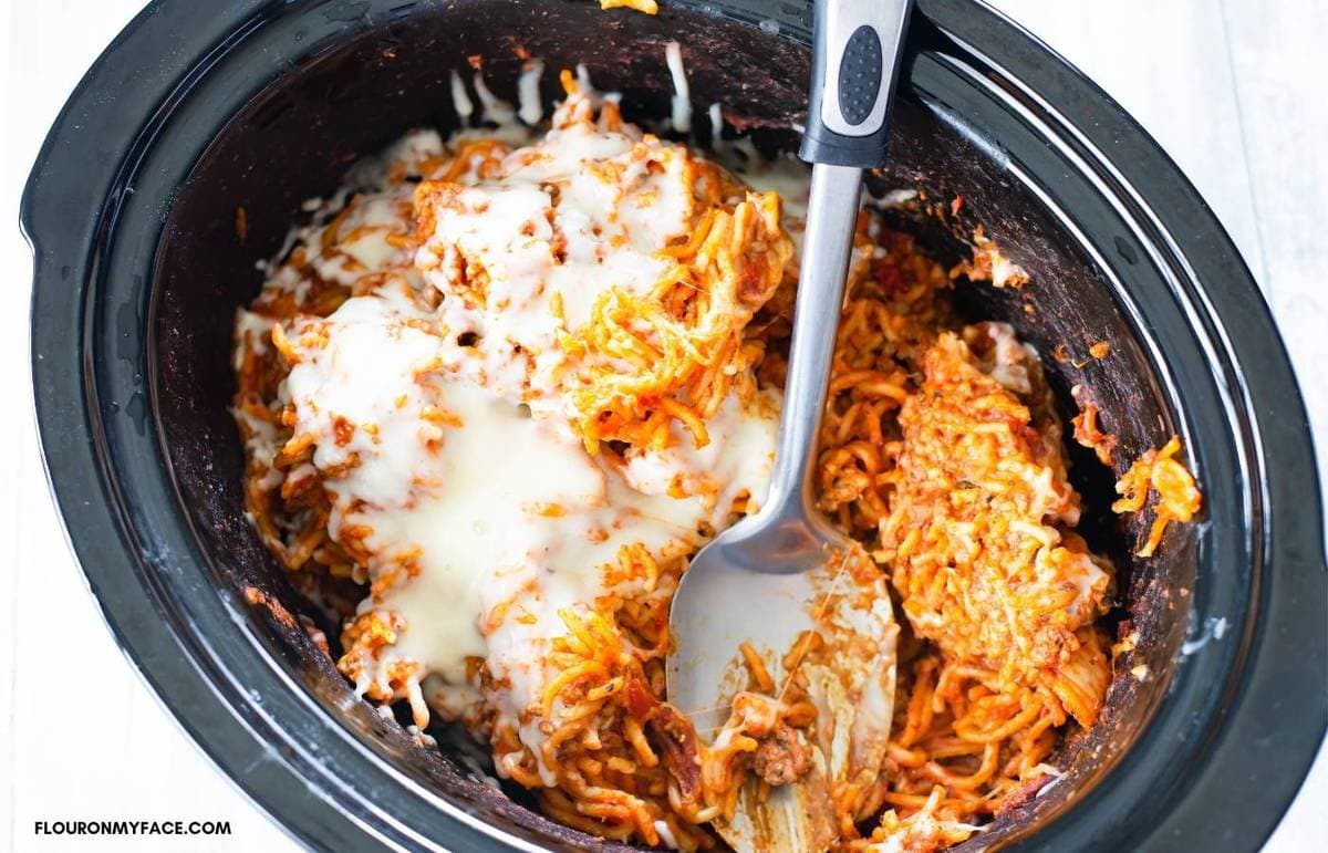 Overhead photo of baked spaghetti in a crock pot.