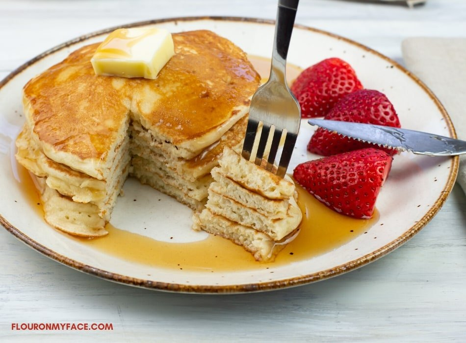 Sourdough pancakes with a slice cut out of the stack