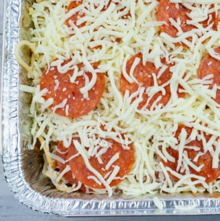 Pepperoni Spaghetti in an aluminum pan before it is baked