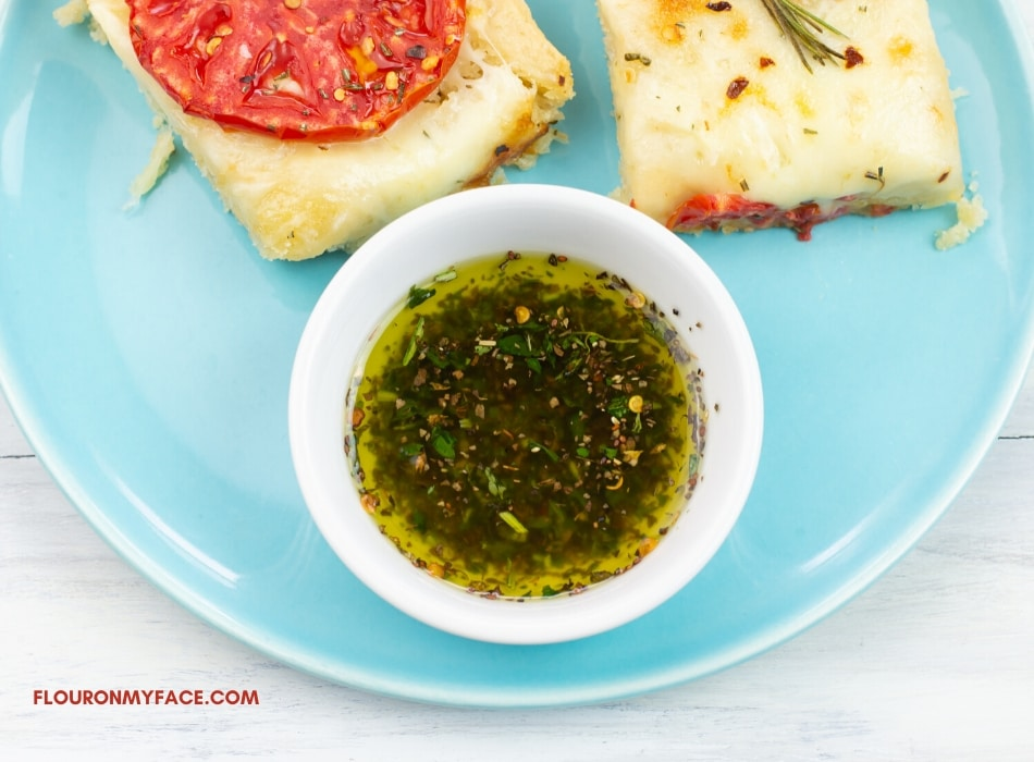 Olive Oil Bread Dip in a small glass dip bowl
