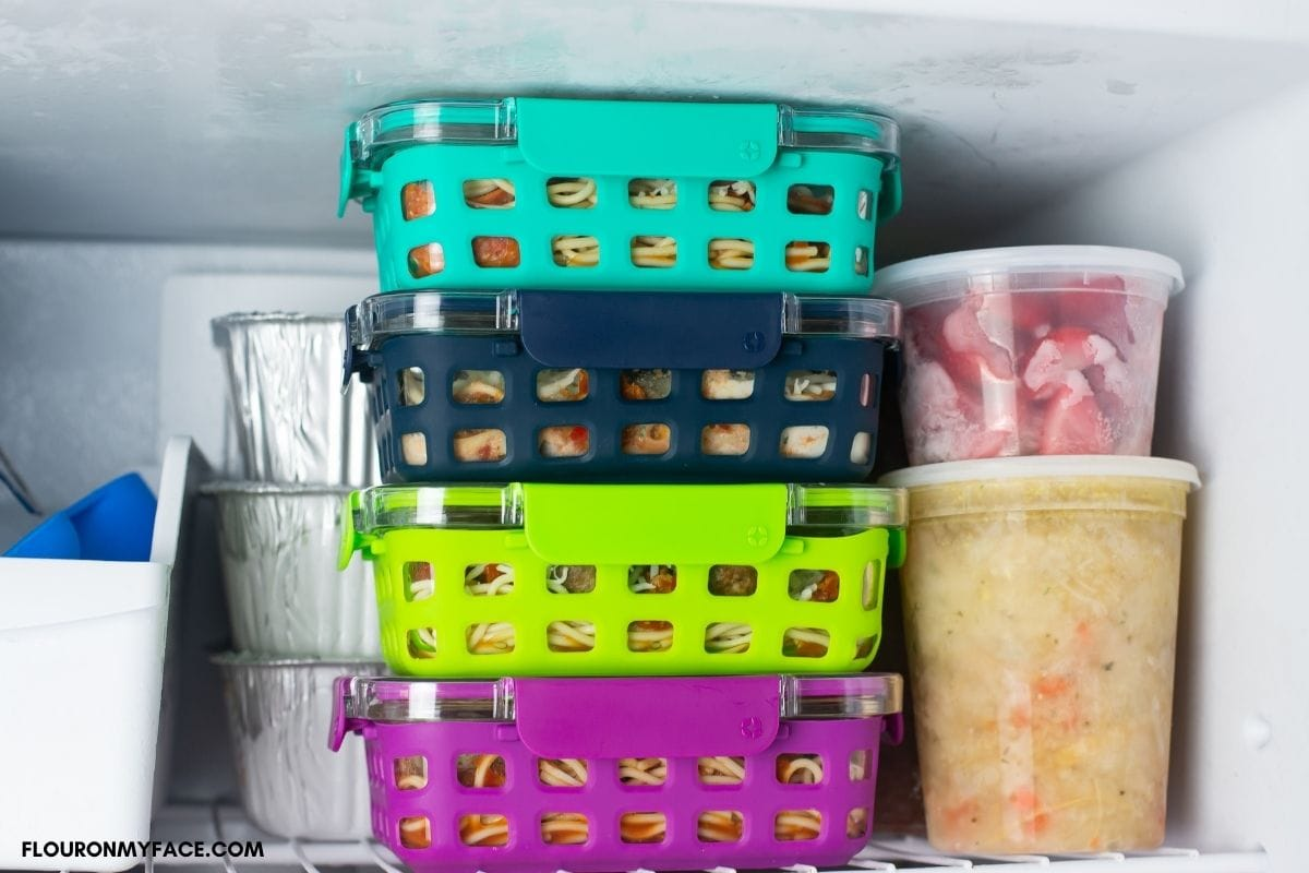 Filled freezer meal containers inside my freezer.