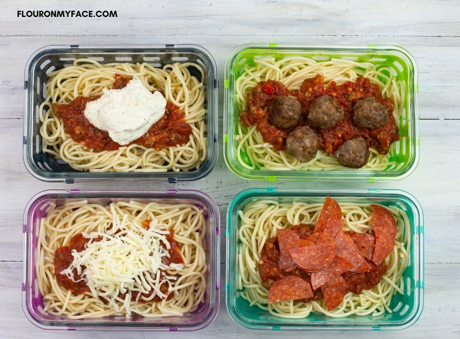 3 meal prep containers filled with freezer meal spaghetti recipes