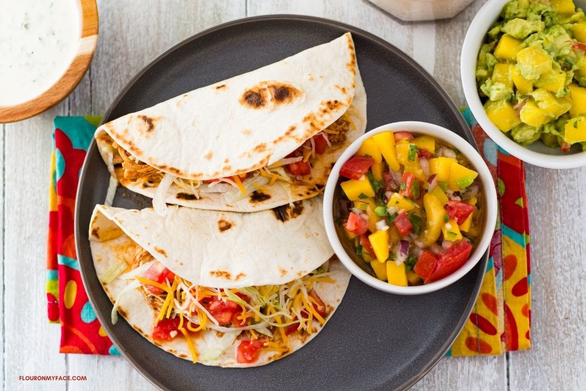 3 ingredient chicken tacos served with all the fixings.