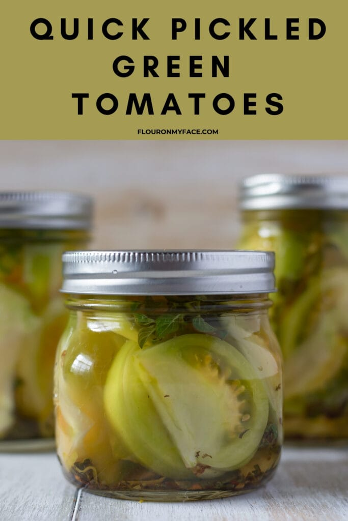 Three mason jars filled with quick pickled green tomatoes