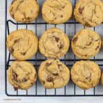 Homemade chocolate chip cookies cooling on a wire cooling rack