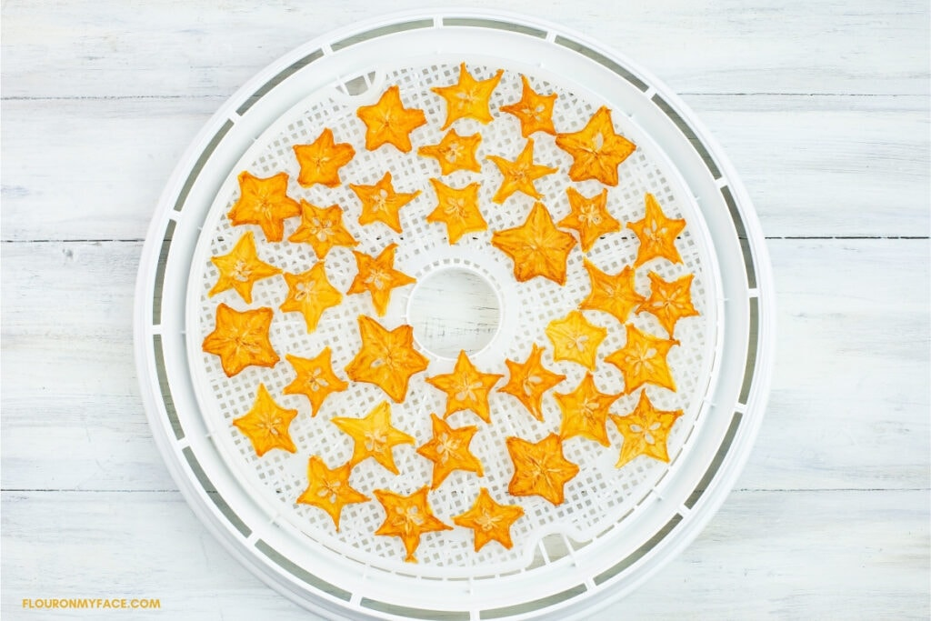 dried star fruit slices on a dehydrator tray
