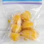 Cubes of frozen carambola juice in a freezer bag