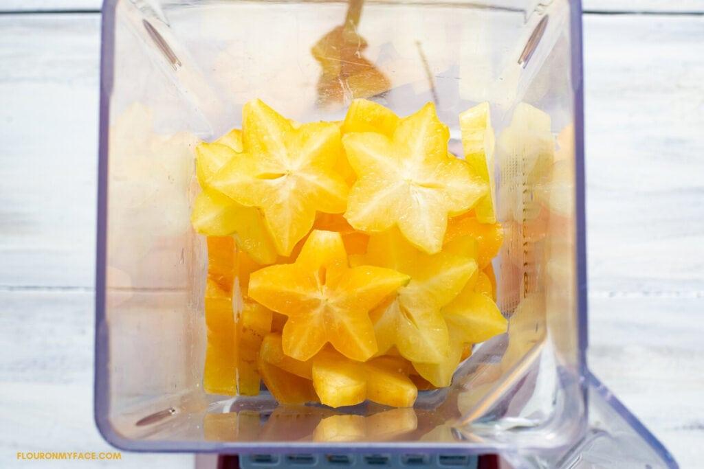 sliced star fruit in a blender