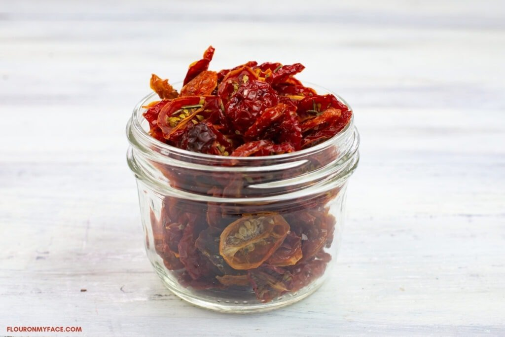 small canning jar filled with dried grape tomatoes