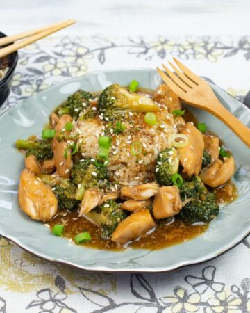 Serving Instant Pot Chicken and Broccoli over a mound of white rice with a bowl of mushroom noodle soup