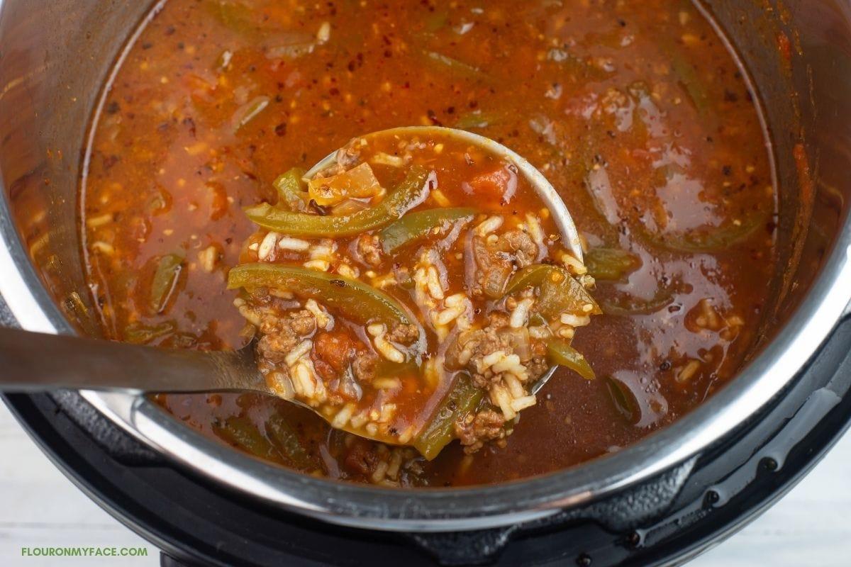 pepper soup in a soup ladle