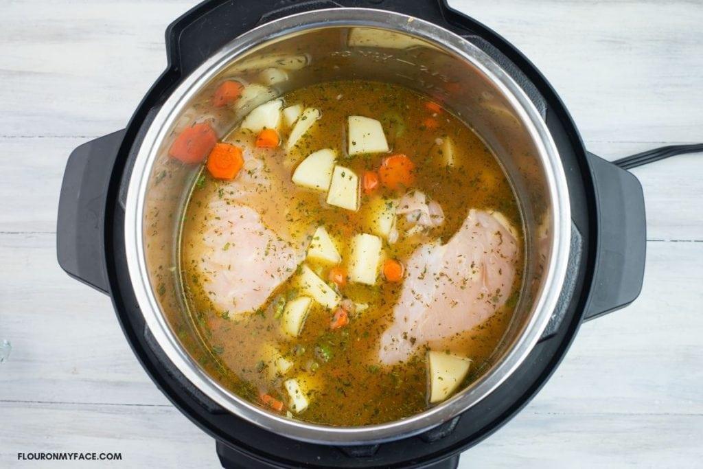 Chicken Stew ingredients in a pressure cooker.