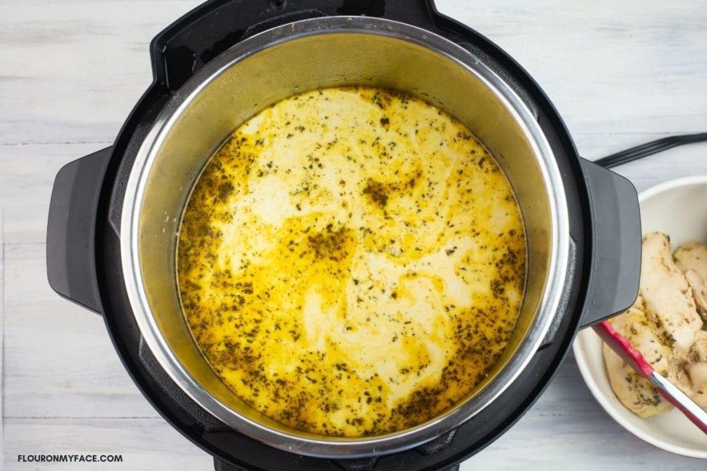 Adding cream and starch slurry to chicken stew.