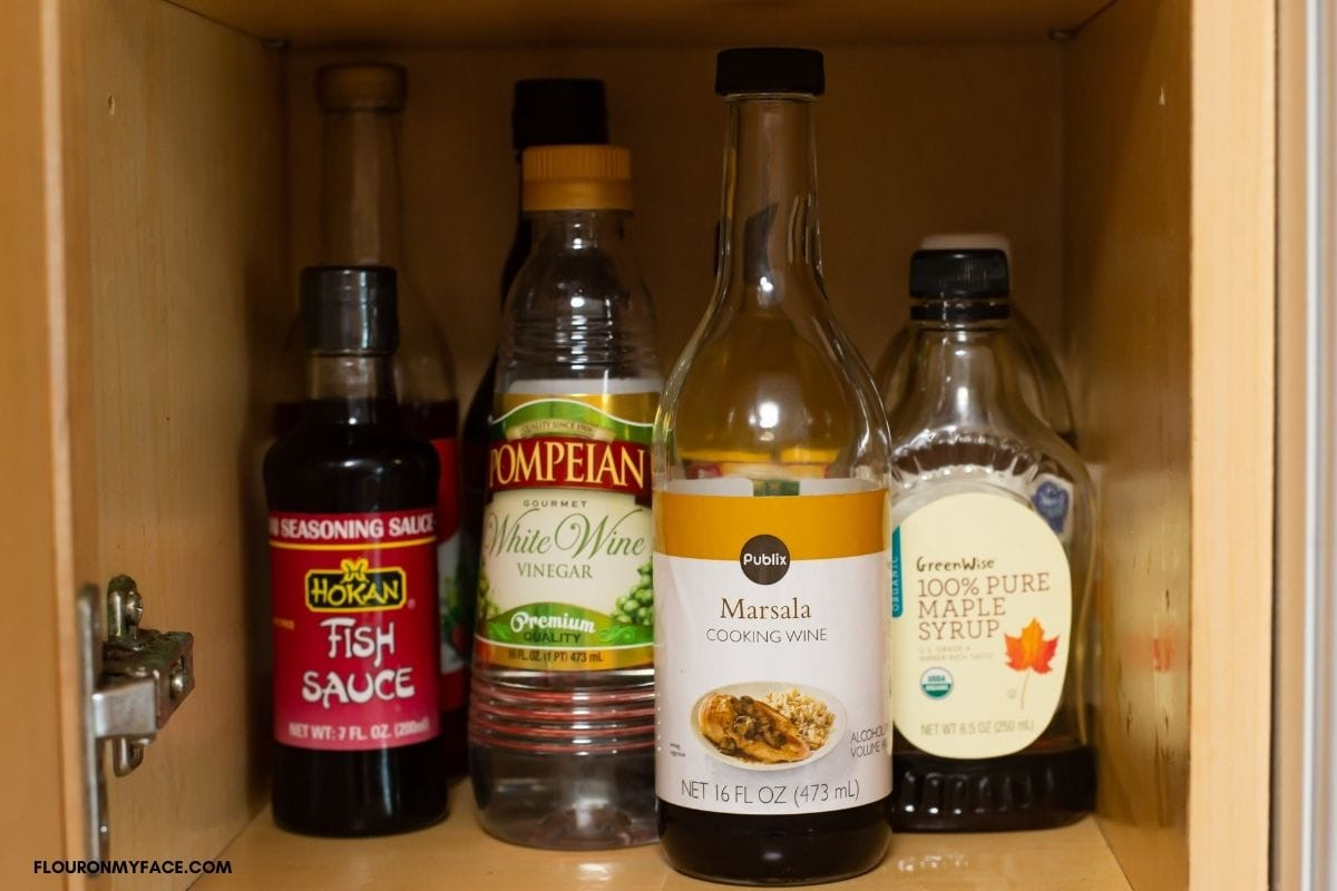 bottle of cooking wine in kitchen cabinet