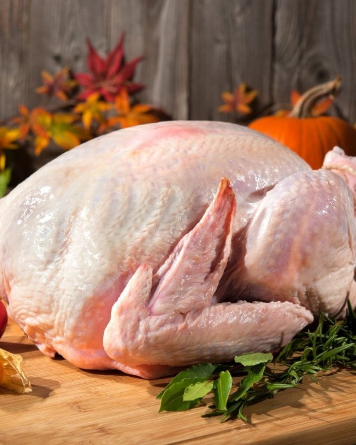 uncooked turkey on a cutting board