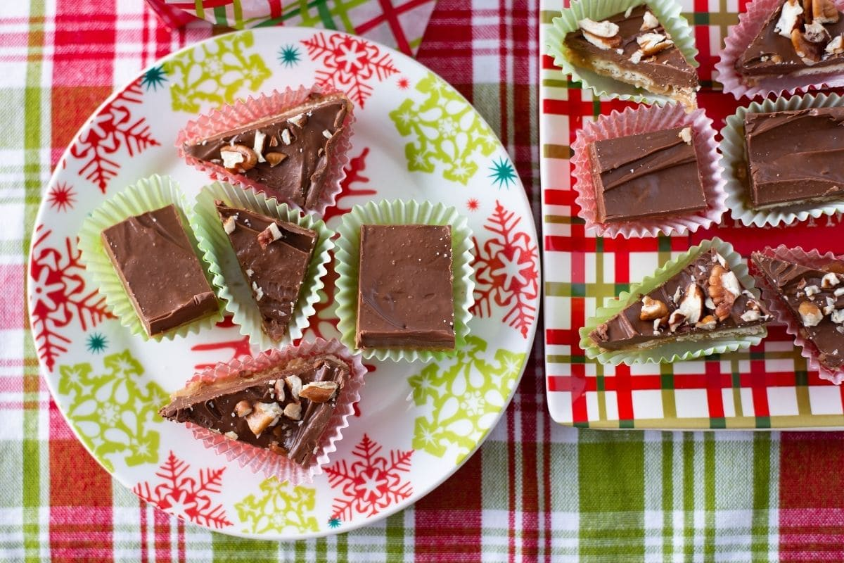 saltine toffee cut into pieces on a holiday plate.