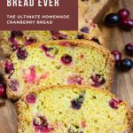 Slice of cranberry bread on cutting board.