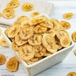 a small bowl filled with dehydrated banana chips.