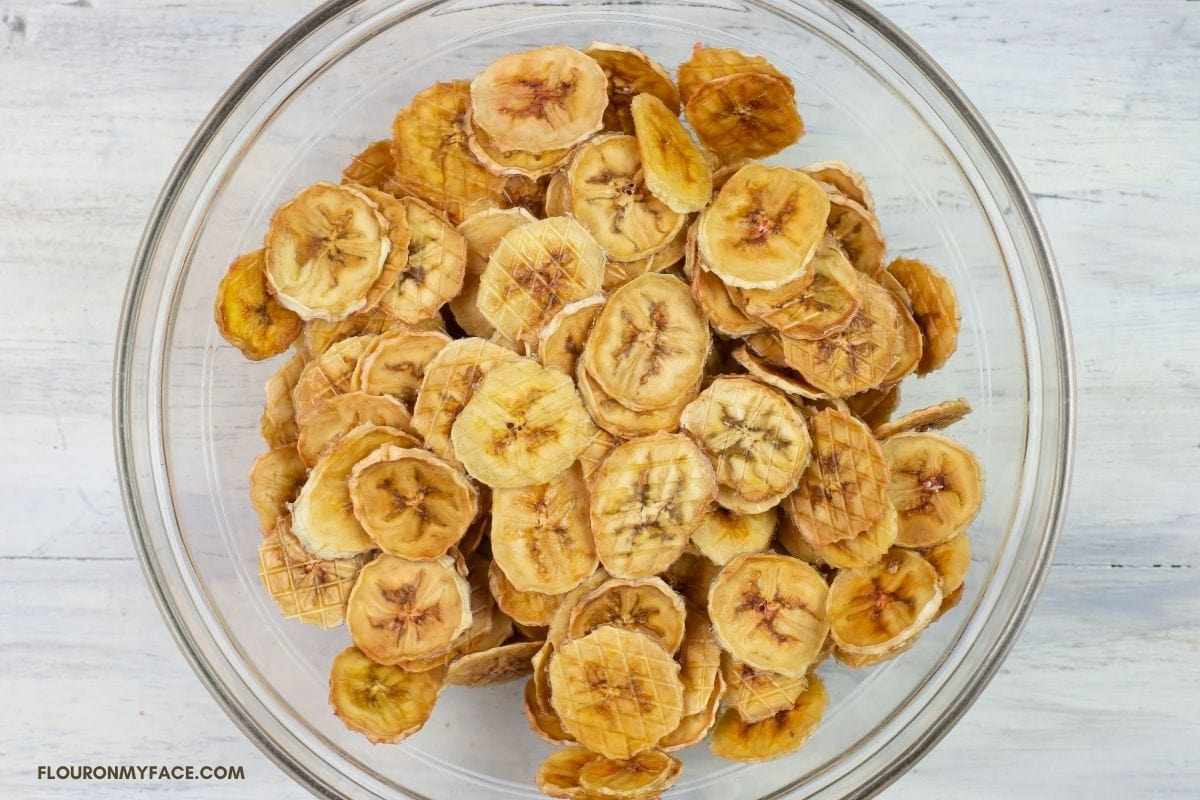 Dried banana chips in a bowl.