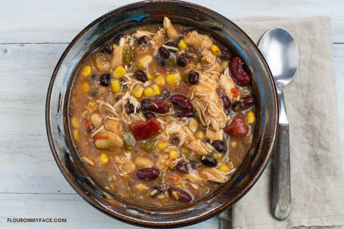 A bowl of chunky chicken chili.