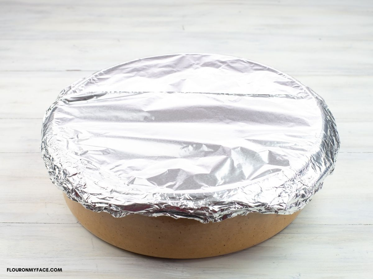 Aluminum covered clay casserole dish.