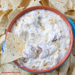 White Queso dip in a dip bowl with chips.