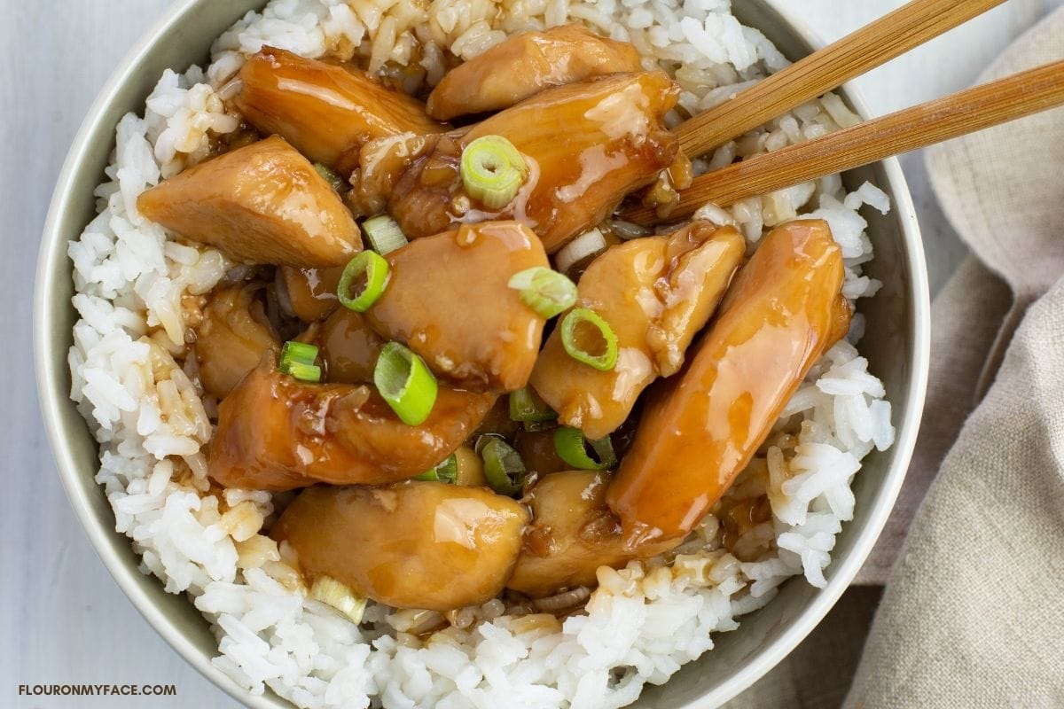 a bowl of rice and bourbon chicken.