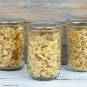 Dehydrated Diced Apple Pieces in small mason jars.
