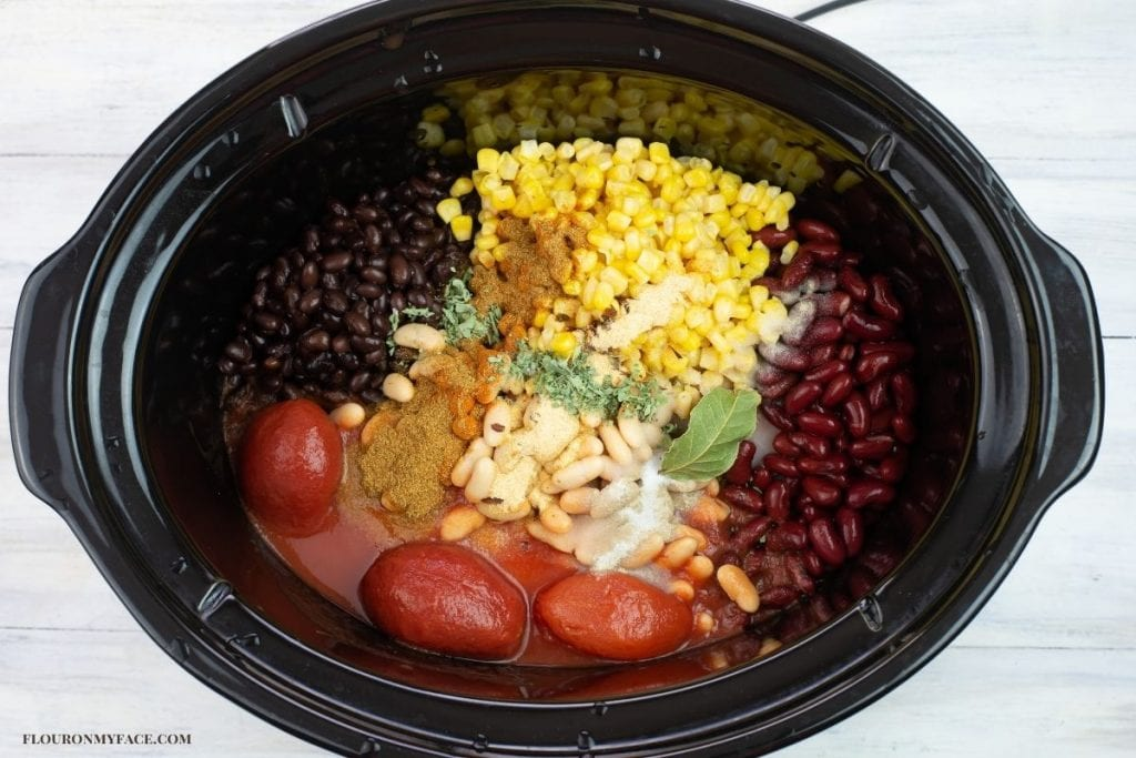 Chicken chili ingredients in a crock pot.