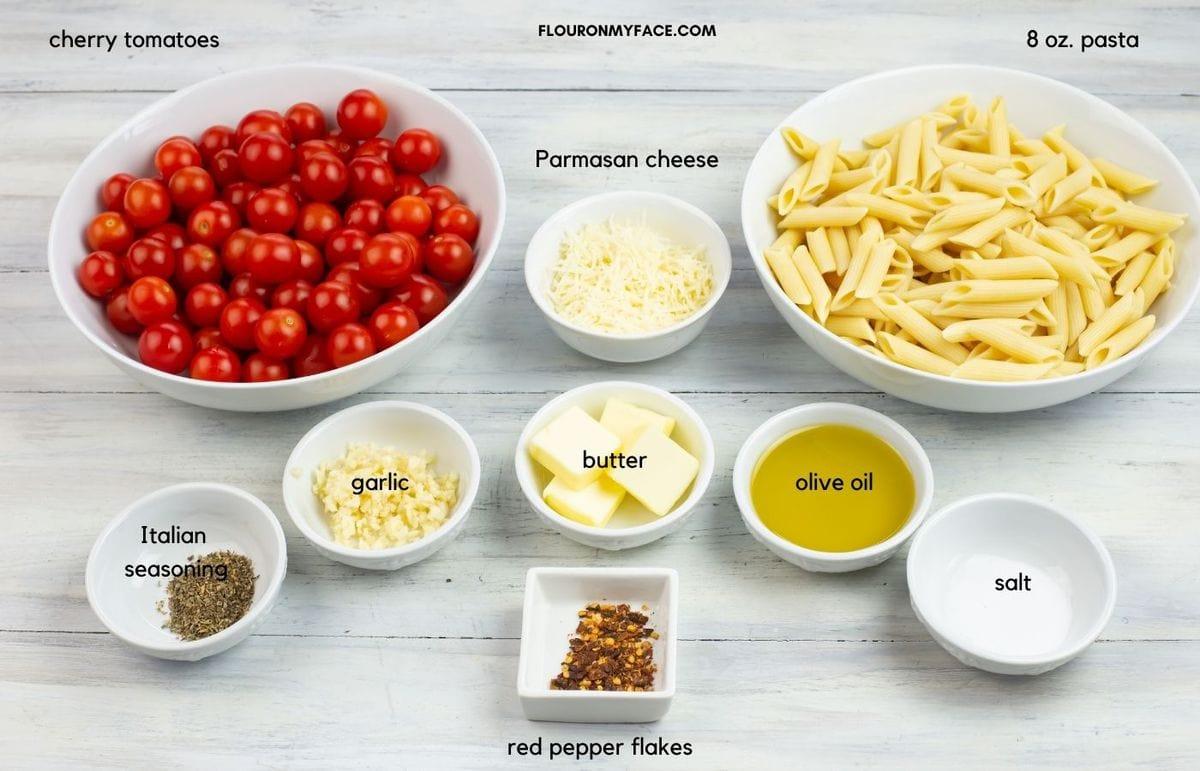 tomato pasta sauce ingredients in individual bowls.