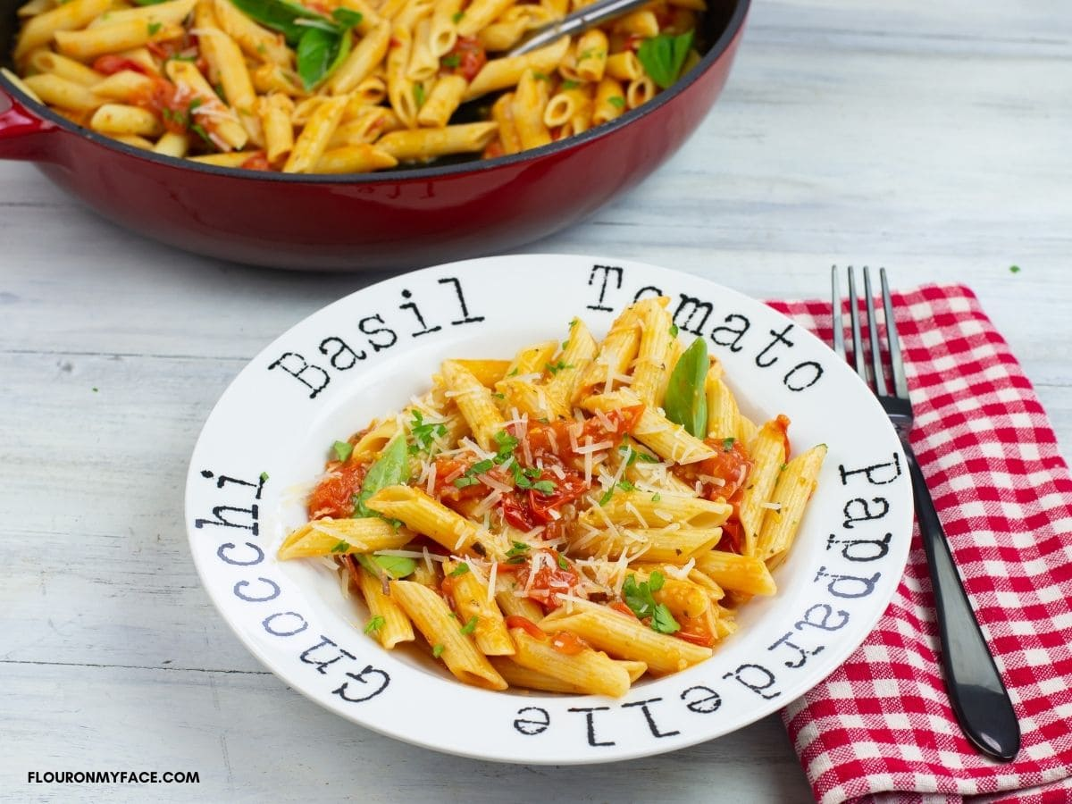 A pasta bowl filled with Penne pasta tossed with homemade tomato sauce.