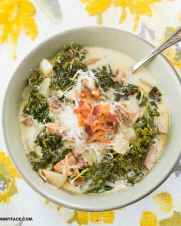 Bowl filled with Zuppa Toscana Soup.
