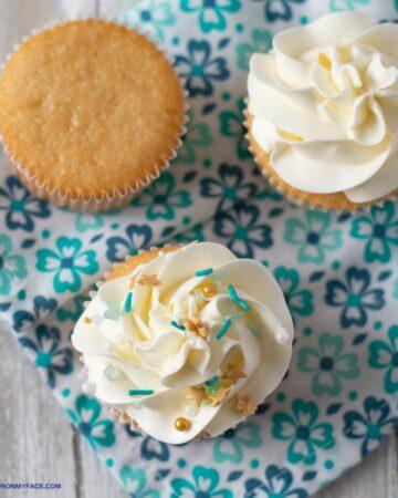 3 Vanilla Cupcakes on a napkin.