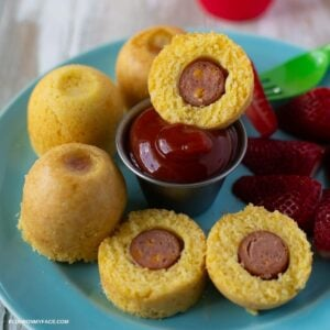 Mini Corn Dog Bites served with ketchup on a blue plate.