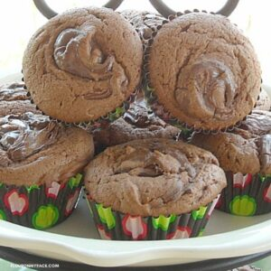 A pile of Nutella Muffins on a plate.