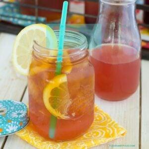 Peach Iced Tea in a mason jar with a straw.