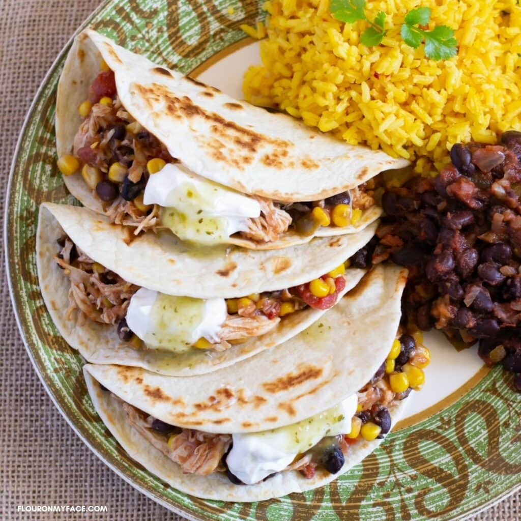 Crock Pot Salsa Chicken recipe served with rice on a plate.