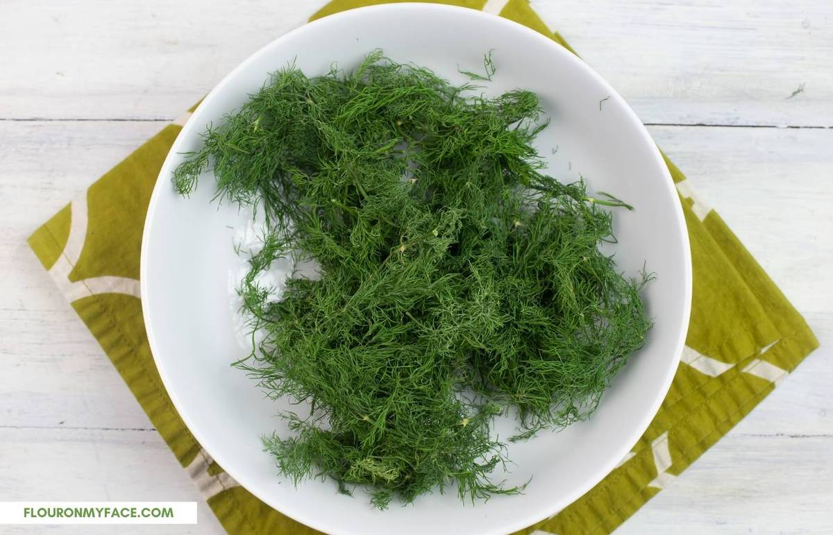 Dried herbs in a white bowl.