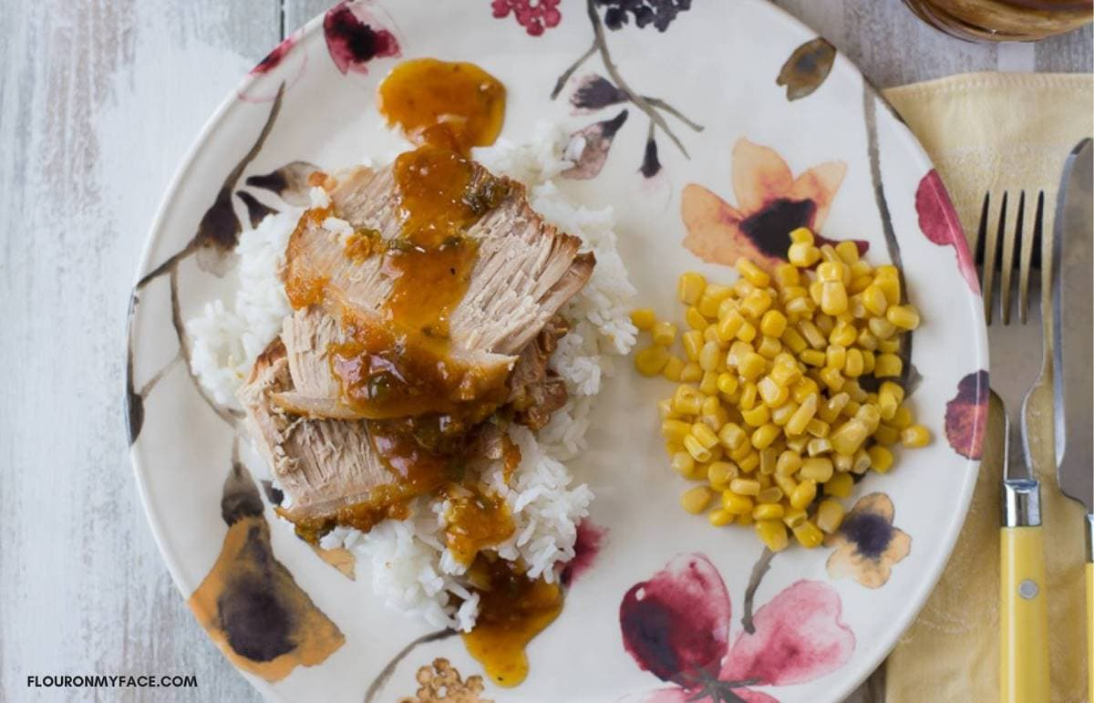 Pork Loin with apricot glaze on a dinner plate.