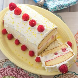 Raspberry and Lemon curd ice box cake on a serving platter.