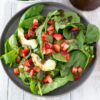balsamic salad dressing drizzled on a spinach salad.